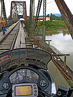 Crossing a bridge in Panama , October 27, 2007..Born in Argentina, photographer Ivan Pisarenko in 2005  decided to ride his motorcycle across the American continent. While traveling Ivan is gathering an exceptional photographic document on the more diverse corners of the region. Archivolatino will publish several stories by this talented young photographer..Closer look at  Ivan's page www.americaendosruedas.com....