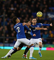 11th January 2020; Goodison Park, Liverpool, Merseyside, England; English Premier League Football, Everton versus Brighton and Hove Albion; Neal Maupay of Brighton and Hove Albion competes for the ball with Mason Holgate and Gylfi Sigurdsson of Everton  - Strictly Editorial Use Only. No use with unauthorized audio, video, data, fixture lists, club/league logos or 'live' services. Online in-match use limited to 120 images, no video emulation. No use in betting, games or single club/league/player publications
