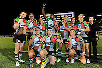 20130803 Copyright onEdition 2013 ©<br /> Free for editorial use image, please credit: onEdition.<br /> <br /> Harlequins 7s celebrate winning the trophy for winning Group C of the J.P. Morgan Asset Management Premiership Rugby 7s Series.<br /> <br /> The J.P. Morgan Asset Management Premiership Rugby 7s Series kicks off for the fourth season on Thursday 1st August with Pool A at Kingsholm, Gloucester with Pool B being played at Franklin's Gardens, Northampton on Friday 2nd August, Pool C at Allianz Park, Saracens home ground, on Saturday 3rd August and the Final being played at The Recreation Ground, Bath on Friday 9th August. The innovative tournament, which involves all 12 Premiership Rugby clubs, offers a fantastic platform for some of the country's finest young athletes to be exposed to the excitement, pressures and skills required to compete at an elite level.<br /> <br /> The 12 Premiership Rugby clubs are divided into three groups for the tournament, with the winner and runner up of each regional event going through to the Final. There are six games each evening, with each match consisting of two 7 minute halves with a 2 minute break at half time.<br /> <br /> For additional images please go to: http://www.w-w-i.com/jp_morgan_premiership_sevens/<br /> <br /> For press contacts contact: Beth Begg at brandRapport on D: +44 (0)20 7932 5813 M: +44 (0)7900 88231 E: BBegg@brand-rapport.com<br /> <br /> If you require a higher resolution image or you have any other onEdition photographic enquiries, please contact onEdition on 0845 900 2 900 or email info@onEdition.com<br /> This image is copyright the onEdition 2013©.<br /> <br /> This image has been supplied by onEdition and must be credited onEdition. The author is asserting his full Moral rights in relation to the publication of this image. Rights for onward transmission of any image or file is not granted or implied. Changing or deleting Copyright information is illegal as specified in the Copyright, Design and