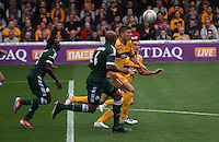 Shaun Hutchinson winning the race for the ball in the Motherwell v Panathinaikos UEFA Champions League 3rd Qualifying Round 1st Leg match at Fir Park, Motherwell on 31.7.12.