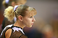 Oct 17, 2006; Aarhus, Denmark; Portrait is of Alina Kozich of Ukraine preparing for balance beam during women's gymnastics team competition at 2006 World Championships Artistic Gymnastics. Photo by Tom Theobald