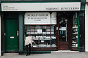 A man peers into the window of Peridot Jewellers, London Road, St Leonards-On-Sea, West Sussex.