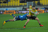Hurricanes captain TJ Perenara is tackled during the Super Rugby Aotearoa match between the Hurricanes and Blues at Sky Stadium in Wellington, New Zealand on Saturday, 18 July 2020. Photo: Dave Lintott / lintottphoto.co.nz