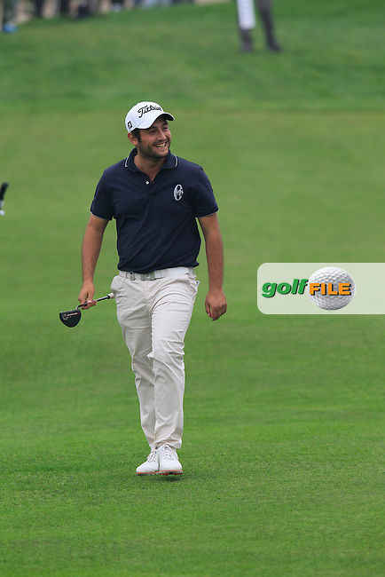 Alexander Levy (FRA) walks to the 17th green during Saturay's Round 3 of the 2014 BMW Masters held at Lake Malaren, Shanghai, China. 1st November 2014.<br /> Picture: Eoin Clarke www.golffile.ie