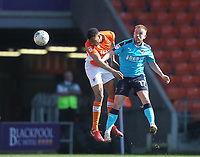 Blackpool's Curtis Tilt jumps with  Fleetwood Town's Paddy Madden<br /> <br /> Photographer Mick Walker/CameraSport<br /> <br /> The EFL Sky Bet League One - Blackpool v Fleetwood Town - Saturday 14th April 2018 - Bloomfield Road - Blackpool<br /> <br /> World Copyright &copy; 2018 CameraSport. All rights reserved. 43 Linden Ave. Countesthorpe. Leicester. England. LE8 5PG - Tel: +44 (0) 116 277 4147 - admin@camerasport.com - www.camerasport.com