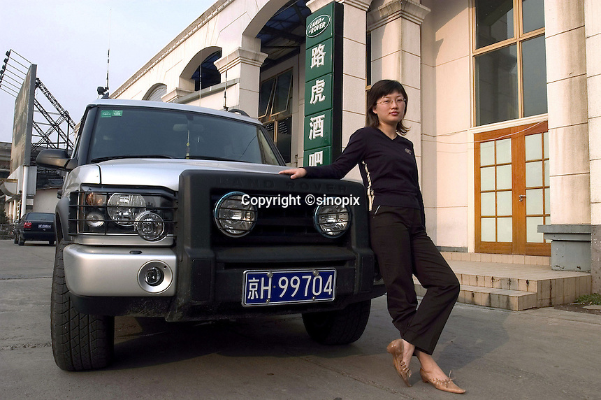 "A Chinese lady with her Land Rover ""Discovery"" in front of the Land Rover Beijing Club, China.."