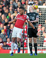 Arsenal's Pierre-Emerick Aubameyang heads past Burnley's Ben Mee<br /> <br /> Photographer David Shipman/CameraSport<br /> <br /> The Premier League - Arsenal v Burnley - Saturday 22nd December 2018 - The Emirates - London<br /> <br /> World Copyright © 2018 CameraSport. All rights reserved. 43 Linden Ave. Countesthorpe. Leicester. England. LE8 5PG - Tel: +44 (0) 116 277 4147 - admin@camerasport.com - www.camerasport.com