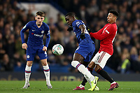30th October 2019; Stamford Bridge, London, England; English Football League Cup, Carabao Cup, Chelsea Football Club versus Manchester United; Jesse Lingard of Manchester Utd challenges Kurt Zouma of Chelsea - Strictly Editorial Use Only. No use with unauthorized audio, video, data, fixture lists, club/league logos or 'live' services. Online in-match use limited to 120 images, no video emulation. No use in betting, games or single club/league/player publications
