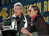 Washington, DC - October 29, 1997 -- Actor Richard Gere and Ania Adhe protest the religious persecution in China at a rally in Lafayette Park across from The White House in Washington, D.C. on October 29, 1997.  The protest coincided with the visit of President Jiang Zemin of China to the White House..Credit: Ron Sachs / CNP