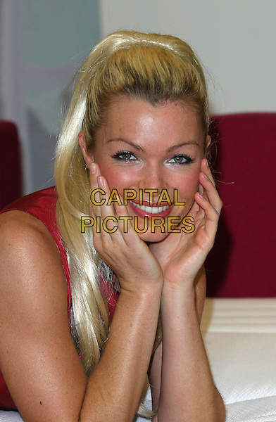 NELL MCANDREW .helps launch Silentnight's new line of bespoke beds and mattresses at the Ideal Home Show, London.10 March 2004.portrait, headshot, hands, hair extensions.www.capitalpictures.com.sales@capitalpictures.com.©Capital Pictures