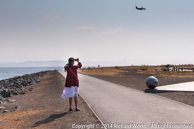 The par course at San Leandro Marina Park is near the incoming flight path to the Oakland International Airport, which often prompts a new visitor to take a picture.