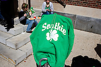 "A green hoodie that says ""Southie"" and has a shamrock on it is displayed for sale on the street at the St. Patrick's Day Parade in South Boston, Massachusetts."
