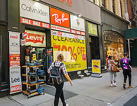 A store in Noho in New York advertises its clearance sale on Friday, May 20, 2016.  (© Richard B. Levine)