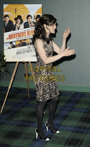 "RACHEL WEISZ.""The Brothers Bloom"" press conference & photocall, Sofitel London, St. James hotel, Waterloo Place, London, England..October 27th, 2008.full length black brown pattern dress hands profile tights white shoes sleeveless.CAP/CAN.©Can Nguyen/Capital Pictures."