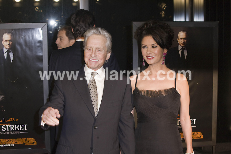 "**ALL ROUND PICTURES FROM SOLARPIX.COM**                                             **SYNDICATION RIGHTS FOR UK, AUSTRALIA, DENMARK, PORTUGAL, S. AFRICA, SPAIN & DUBAI (U.A.E) & ASIA (EXCLUDING JAPAN) ONLY**                                                                                  Caption: ""Wall Street: Money Never Sleeps"" New York City Premiere - Arrivals, Ziegfeld Theatre, NY, USA, 20 September 2010                                                                             This pic: Michael Douglas and Catherine Zeta Jones                                                                                            JOB REF: 12163   PHZ norfleet  DATE: 20_09_2010                                                            **MUST CREDIT SOLARPIX.COM OR DOUBLE FEE WILL BE CHARGED**                                                                      **MUST AGREE FEE BEFORE ONLINE USAGE**                               **CALL US ON: +34 952 811 768 or LOW RATE FROM UK 0844 617 7637**"
