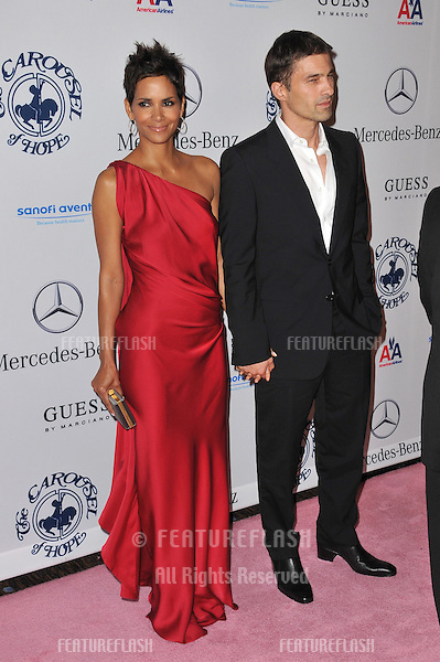 Halle Berry & boyfriend Olivier Martinez at the 32nd Anniversary Carousel of Hope Ball, to benefit the Barbara davis Center for Childhood Diabetes, at the Beverly Hilton Hotel..October 23, 2010  Beverly Hills, CA.Picture: Paul Smith / Featureflash