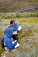 Artist Edward Rooks teaches a field drawing class on Westpoint Island, Falkland Islands