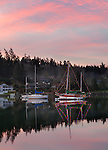 Vashon Island, Washington<br /> Winter sunset over Quartermaster Harbor and boats with Christmas lights