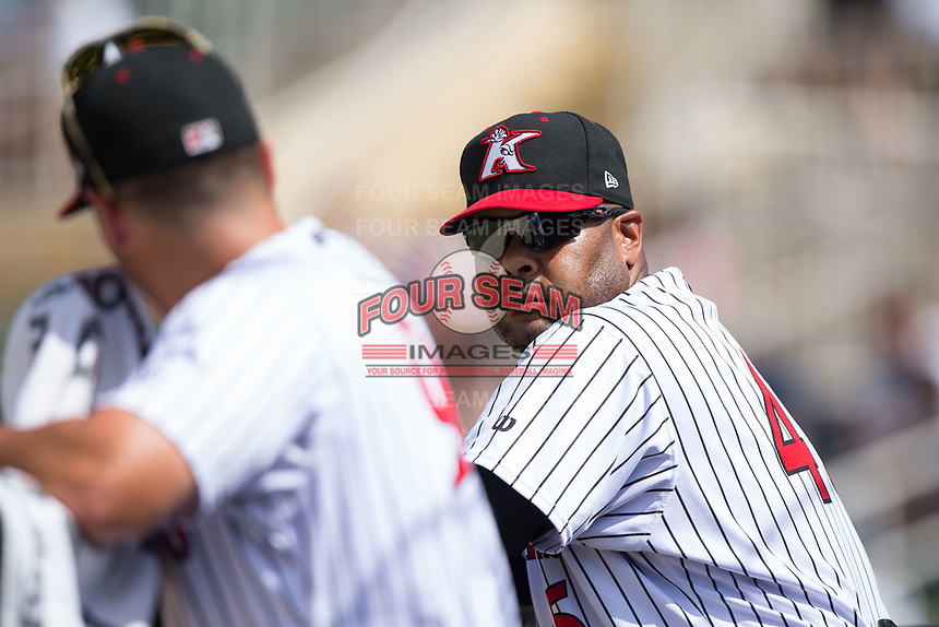 Kannapolis Intimidators hitting coach Jamie Dismuke (45) listens to manager Justin Jirschele during the game against the West Virginia Power at Kannapolis Intimidators Stadium on June 18, 2017 in Kannapolis, North Carolina.  The Intimidators defeated the Power 5-3 to win the South Atlantic League Northern Division first half title.  It is the first trip to the playoffs for the Intimidators since 2009.  (Brian Westerholt/Four Seam Images)