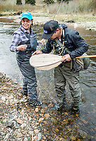 Fish Camp Manager Scott Tarrant shows off worms and bugs to lure trout to Lois Friedland while fishing near Colorado Springs, Colorado, Monday, May 4, 2015. <br /> <br /> Photo by Matt Nager