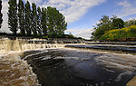 Fast flowing waters on the wier of the river Ure at Boroughbridge, North Yorkshire, England.