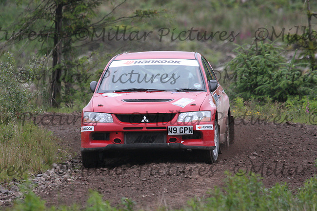 Craig McMiken - Susan Shanks in their Mitsubishi Lancer Evo 9 near Junction 6 on SS1 Ae East.....