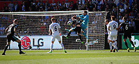 Kristoffer Nordfeldt of Swansea City  saves the ball while challenged by Craig Dawson of West Bromwich Albion during the Premier League match between Swansea City and West Bromwich Albion at The Liberty Stadium, Swansea, Wales, UK. Sunday 21 May 2017