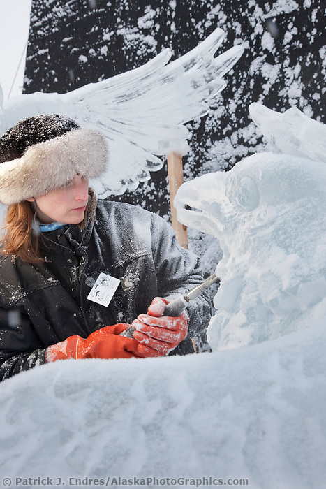 "Alaska artists Heather Brice carves away at a single block realistic category ice sculpture title ""Finders Keepers"" during the 2009 World Ice Art Championships in Fairbanks, Alaska."