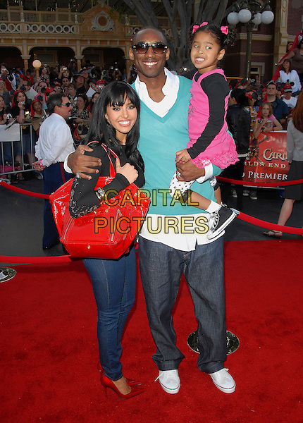 "VANESSA BRYANT, KOBE BRYANT & DAUGHTER.Attends The Walt Disney Pictures' World Premiere of ""Pirates of The Caribbean: At World's End"" held at Disneyland in Anaheim, California, USA, May 19 2007..full length sunglasses green sweater top jumper jeans family.CAP/DVS.©Debbie VanStory/Capital Pictures"