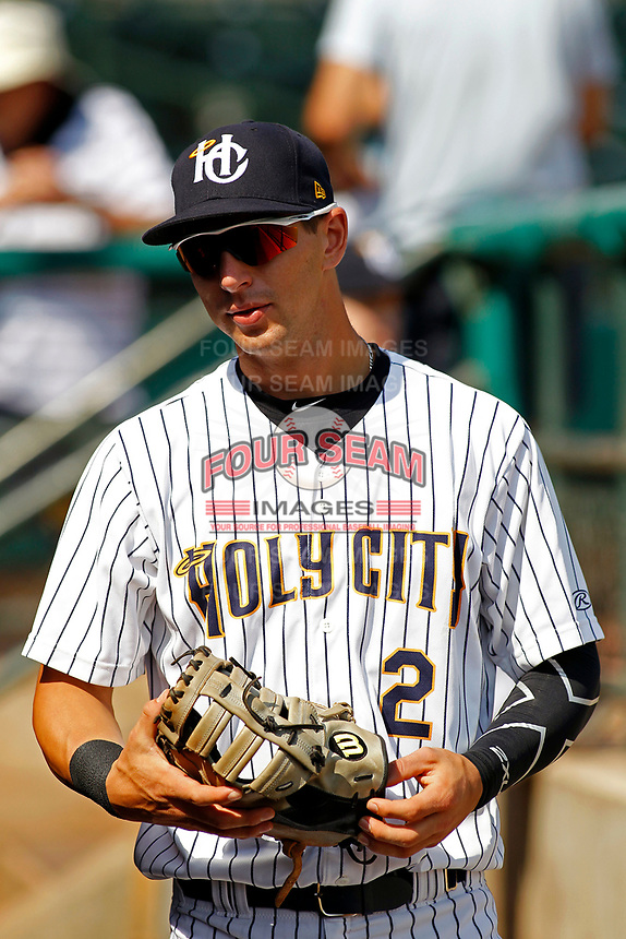 "Charleston Riverdogs infielder Chris Hess (2) before a game against the Hickory Crawdads at the Joseph P. Riley For Sunday games, the Riverdogs wear their ""Holy City"" uniforms in honor of the city's nickname. Hickory defeated Charleston 8-7. (Robert Gurganus/Four Seam Images)"