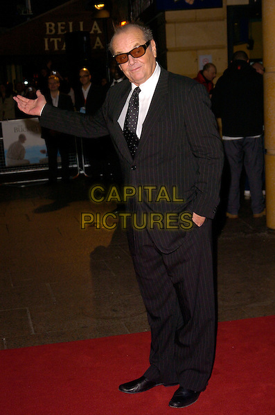 "JACK NICHOLSON.UK Premiere of ""The Bucket List"" held at the Vue cinema, Leicester Square, London, England..January 23rd, 2008    .full length black pinstripe suit sunglasses shades tinted glasses hand in pocket.CAP/CAN.©Can Nguyen/Capital Pictures."