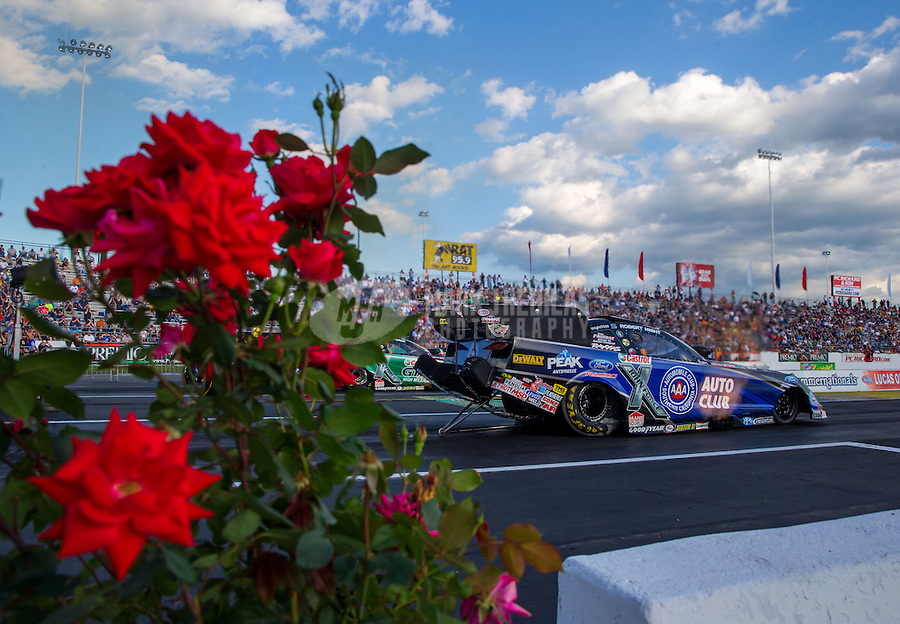 May 30, 2014; Englishtown, NJ, USA; NHRA funny car driver Robert Hight during qualifying for the Summernationals at Raceway Park. Mandatory Credit: Mark J. Rebilas-