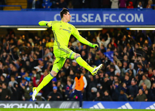 April 25th 2017, Stamford Bridge, Chelsea, London England; EPL Premier league football, Chelsea FC versus Southampton; Chelsea Goalkeeper Thibaut Courtois jumps in celebration after Diego Costa of Chelsea makes it 3-1 in the 53rd minute