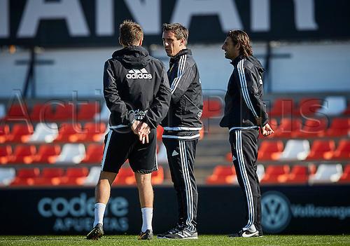 03.24.2016. Valencia CF Sports City, Training session. Valencia CF  Head coach Gary Neville (C)  talks to Assistant Coach Phil Neville during a training session.