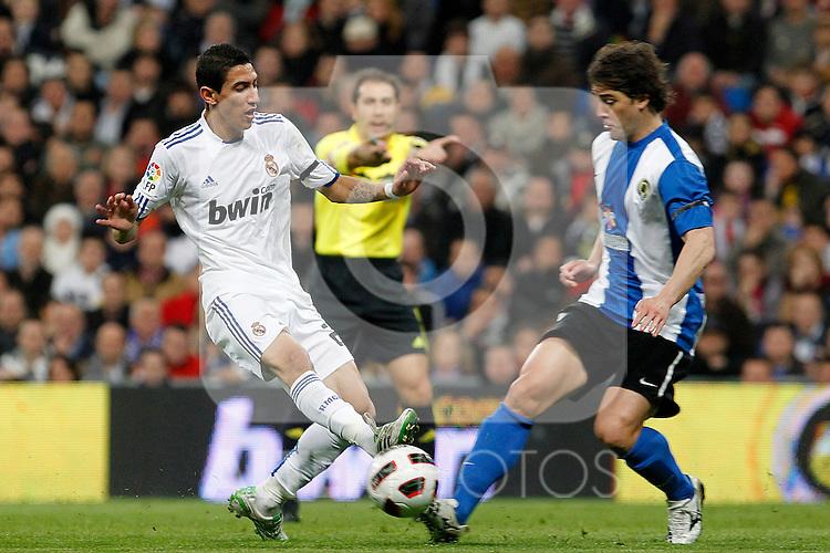 Real Madrid's Angel Di Maria (l) and Hercules' Kiko Femenia Far during La Liga match.March 12,2011. (ALTERPHOTOS/Acero)