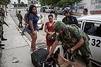 June 17, 2018: Passengers of a taxi service await as Mexican army soldiers look for drugs and weapons at a flying check point set up at La Sabana, a violence-plagued neighbourhood in the outskirts of Acapulco, Guerrero. A juncture of security forces, among them military, marines, federal police and local police joined under one-command to fight crime violence in the region.