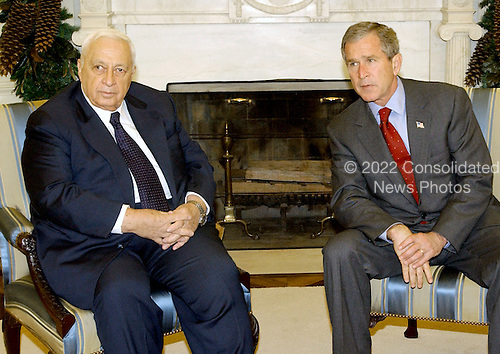 United States President George W. Bush meets Prime Minister Ariel Sharon of Israel in the Oval Office of the White House in Washington, D.C. on December 1, 2001.  The meeting was moved a day than planned earlier following the terrorist bombings in Israel.<br /> Credit: Ron Sachs / CNP