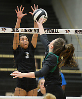 NWA Democrat-Gazette/ANDY SHUPE<br /> Bentonville's Trinity Hamilton (3) reaches to block a shot by Van Buren's Zoe Morrison Tuesday, Sept. 10, 2019, during play in Tiger Arena in Bentonville. Visit nwadg.com/photos to see more photos from the match.