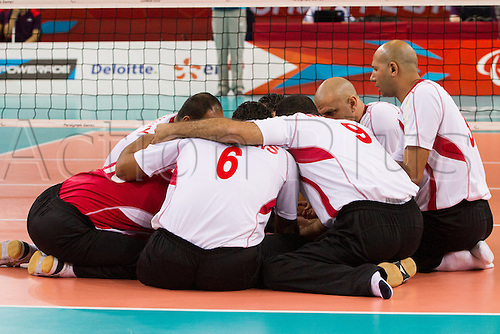 31.08.2012 London, England. Egypt team talk  during the Sitting Volleyball Preliminary Round game between Great Britain (GBR) and Egypt (EGY) on Day 2 of the London 2012 Paralympic Games at Excel Exhibition Centre.