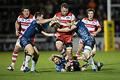 29th September 2017, AJ Bell Stadium, Salford, England; Aviva Premiership Rugby, Sale Sharks versus Gloucester; Gloucester Rugby's Ruan Ackermann is tackled by Sale Sharks' Faf de Klerk and Sale Sharks' AJ MacGinty