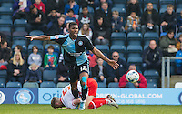 Rowan Liburd of Wycombe Wanderers leaves Fraser Franks of Stevenage grounded during the Sky Bet League 2 match between Wycombe Wanderers and Stevenage at Adams Park, High Wycombe, England on 12 March 2016. Photo by Andy Rowland/PRiME Media Images.