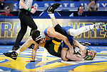 BROOKINGS, SD - FEBRUARY 11: Danny Vega from South Dakota State University battles with McGuire Midkiff from North Dakota State University during their 125 pound match Friday night at Frost Arena in Brookings, SD. (Photo by Dave Eggen/Inertia)