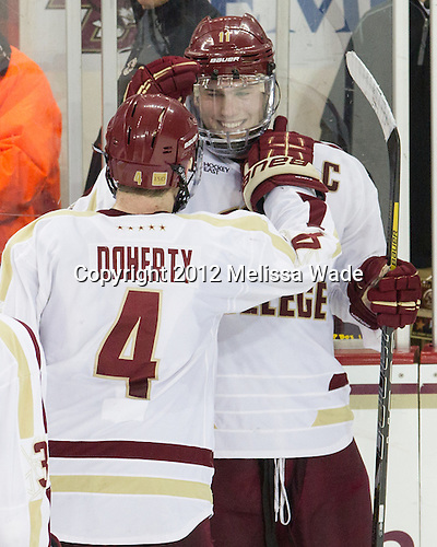 Pat Mullane (BC - 11), Michael Matheson (BC - 5) - The Boston College Eagles defeated the visiting Boston University Terriers 5-2 on Saturday, December 1, 2012, at Kelley Rink in Conte Forum in Chestnut Hill, Massachusetts.