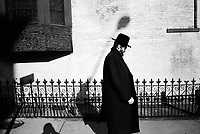 UNITED STATES / Brooklyn / Williamsburg / January 2002..A Hasidic Jewish man along a street in the Hasidic neighborhood of Williamsburg, Brooklyn...© Davin Ellicson / Anzenberger