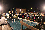 Onlookers watch as four University of Kentucky students jump into the cold water at the Phi Sigma Kappa Polar Plunge on south campus benefitting Special Olympics in Lexington, Ky., on Thursday, Nov. 14, 2013. Photo by Marcus Dorsey | Staff