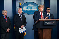 United States President Donald J. Trump delivers remarks on the COVID-19 (Coronavirus) pandemic alongside members of the Coronavirus Task Force in the Brady Press Briefing Room at the White House in Washington, DC, March 25, 2020, in Washington, D.C.  Standing behind the President, from left to right: Director of the National Institute of Allergy and Infectious Diseases at the National Institutes of Health Dr. Anthony Fauci; US Vice President Mike Pence; and US Secretary of the Treasury Steven T. Mnuchin.<br /> Credit: Sarah Silbiger / Pool via CNP/AdMedia