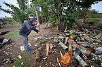 A man chops firewood in Tuixcajchis, a small Mam-speaking Maya village in Comitancillo, Guatemala.
