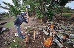 A man chops firewood in Tuixcajchis, a small Mam-speaking Maya village in Comitancillo, Guatemala.