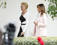 Polish First Lady Agata Kornhauser-Duda (L) and First Lady Melania Trump  walk along the Colonnade at the White House in Washington, DC, USA, 12 June 2019. During the visit President Trump and President Duda will participate in a signing ceremony to increase military to military cooperation including the purchase of F-35 fighter jets and an increased US troop presence in Poland. <br /> Credit: Shawn Thew / Pool via CNP/AdMedia