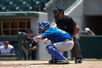 Durham Bulls catcher Nick Ciuffo (19) sets a target as home plate umpire Erich Bacchus looks on during the game against the Charlotte Knights at BB&T BallPark on May 27, 2019 in Charlotte, North Carolina. The Bulls defeated the Knights 10-0. (Brian Westerholt/Four Seam Images)